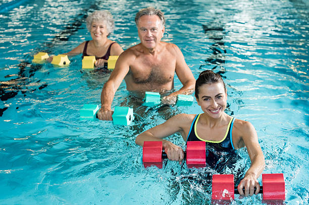 Gymnastics physiotherapy with dumbbells - foto stock