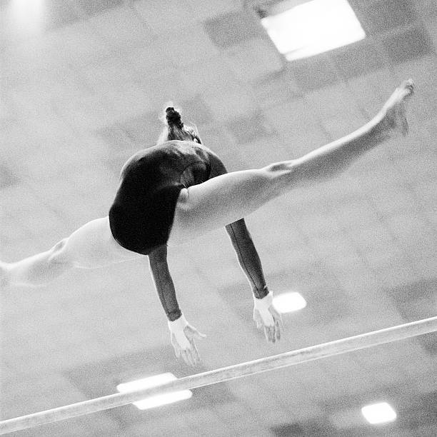 gymnastics - uneven parallel bars stock photos and pictures