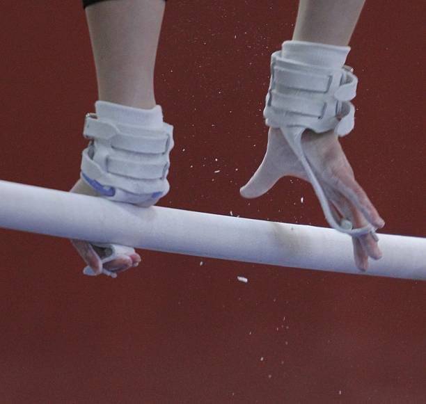 gymnasts hands - uneven parallel bars stock photos and pictures