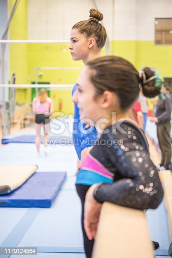 Gymnasts Preparing for Their Exercises on Balance Beam