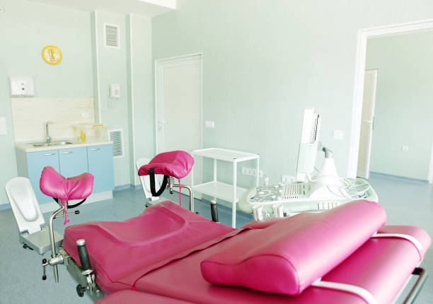 gynecological chair in gynecological room - abortion stock photos and pictures