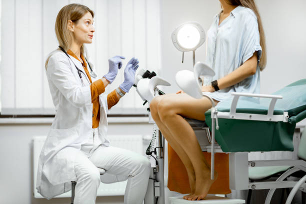 Gynecologist with patient in the office stock photo