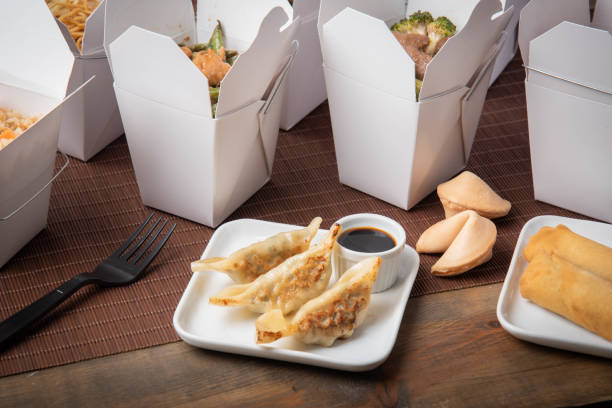gyoza dumpling with american chinese food container stock photo