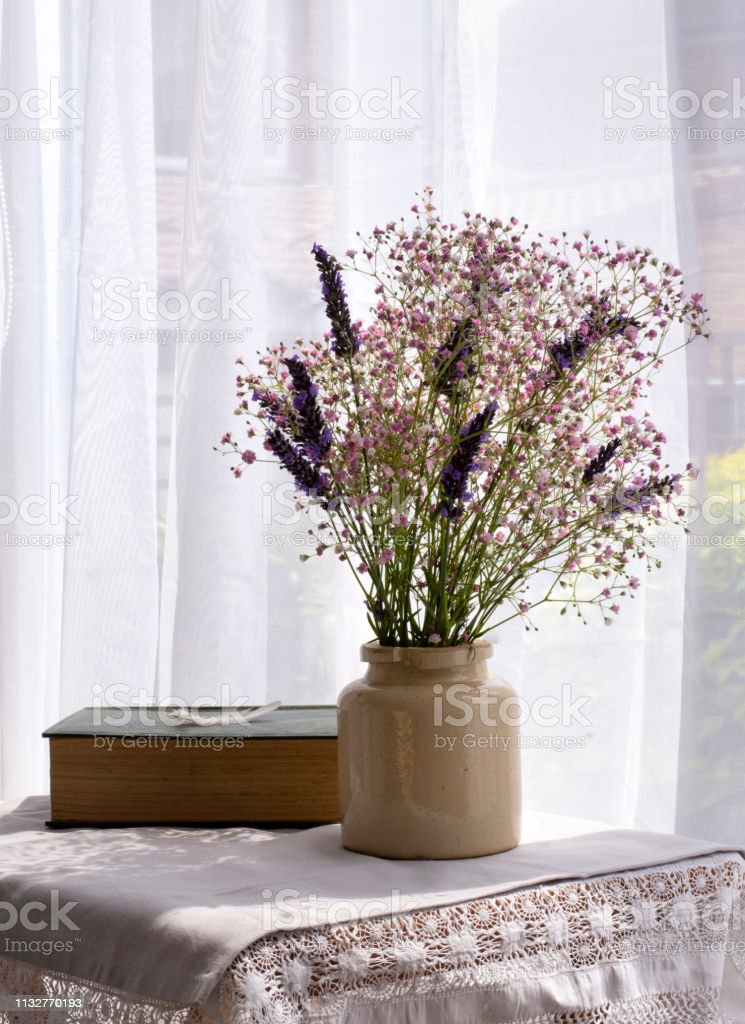 Gypsophila and Lavender by a bright window stock photo