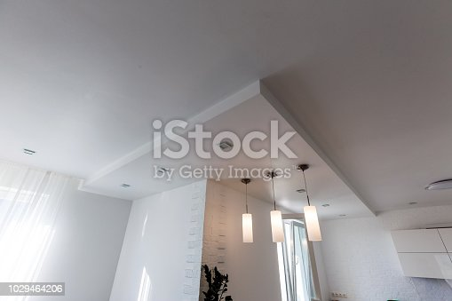 istock Gypsum board ceiling of house at construction site 1029464206