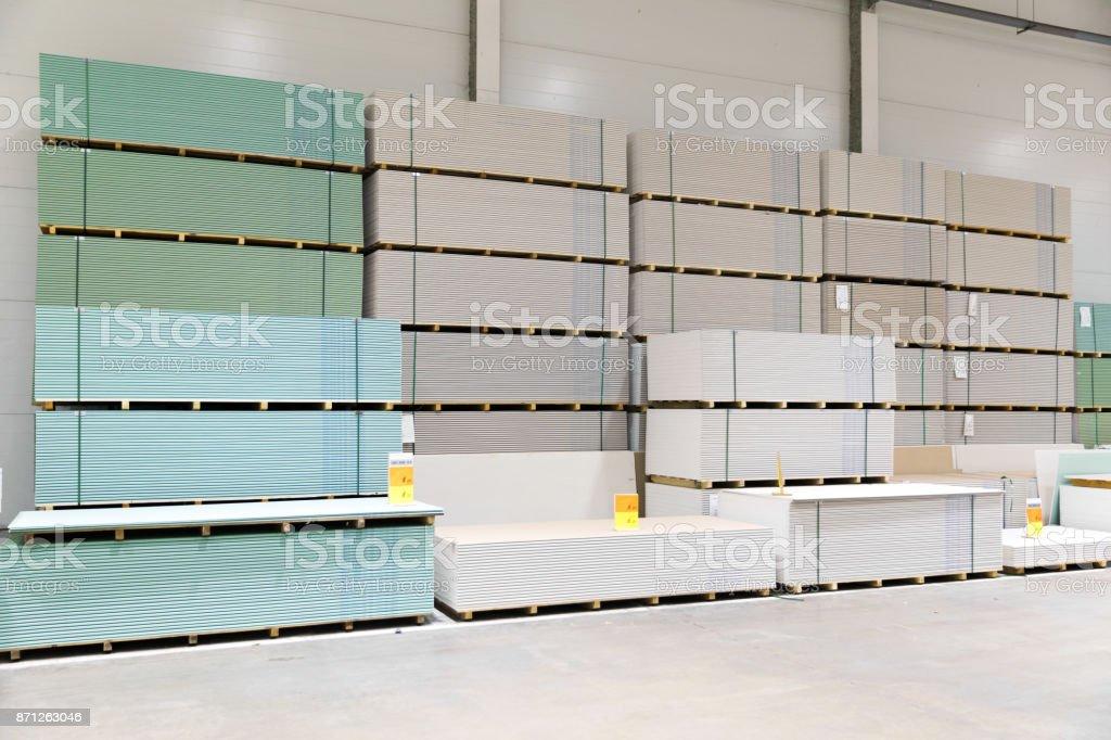 gypsum board stacks at indoor warehouse stock photo