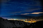 Gypsum Colorado Night Time Exposure in Winter - Night photography of town lit up in valley surrounded by mountains with views of the stars and sky. Gypsum, Colorado, Vail Valley, Colorado USA.