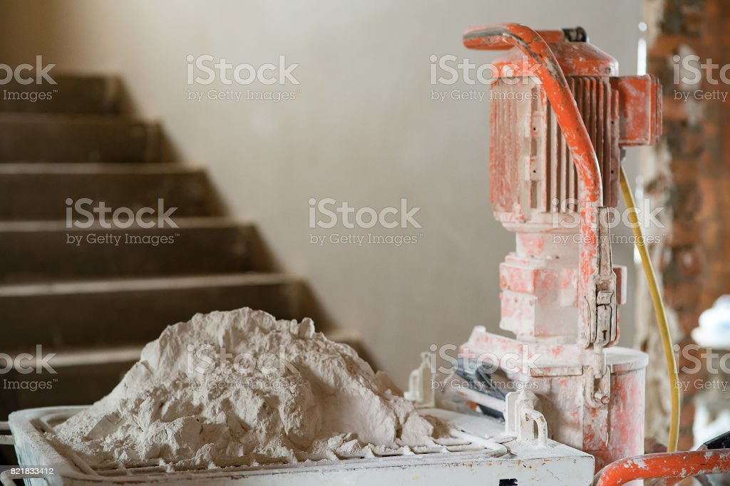 Gypsum for machine wall plastering stock photo