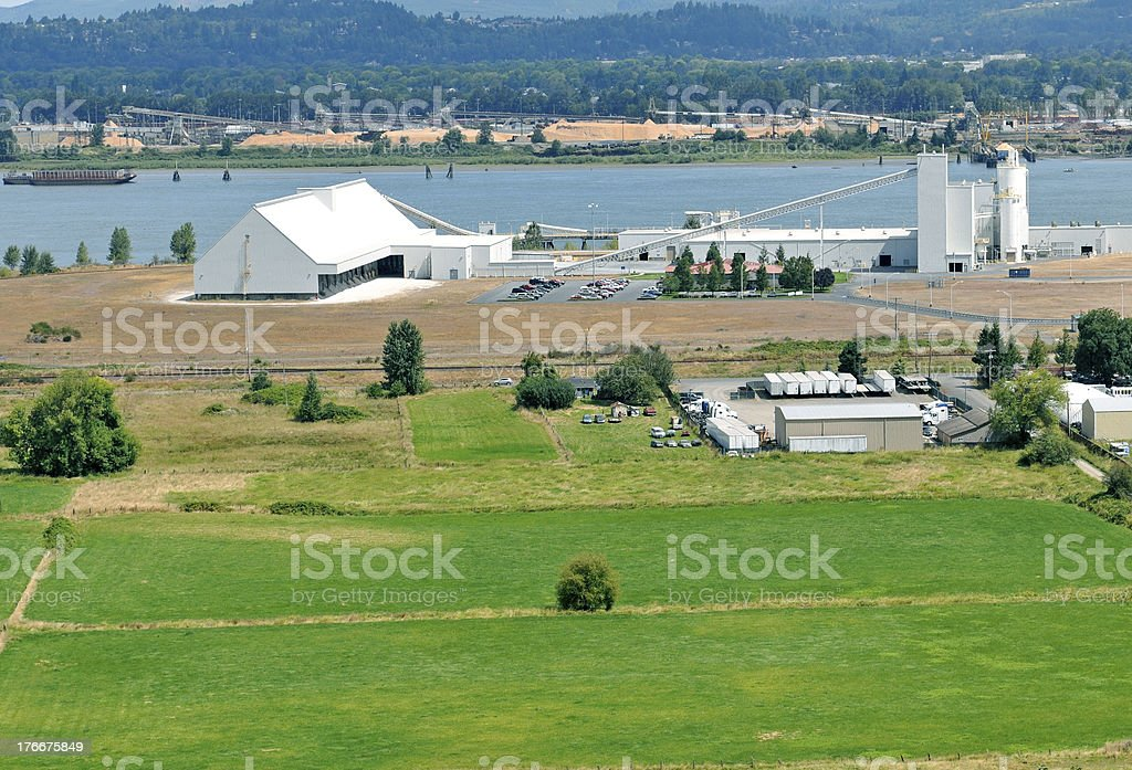 Gypsum production plant and farmland on river in Oregon royalty-free stock photo
