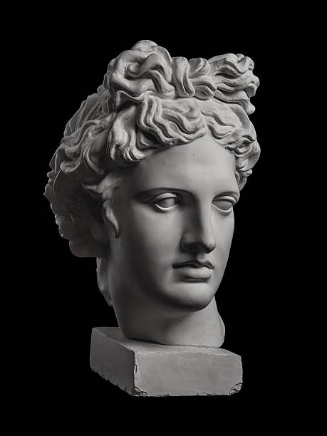Gypsum statue of Apollo's head on a black background stock photo