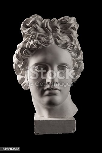 istock Gypsum statue of Apollo's head on a black background 616250878