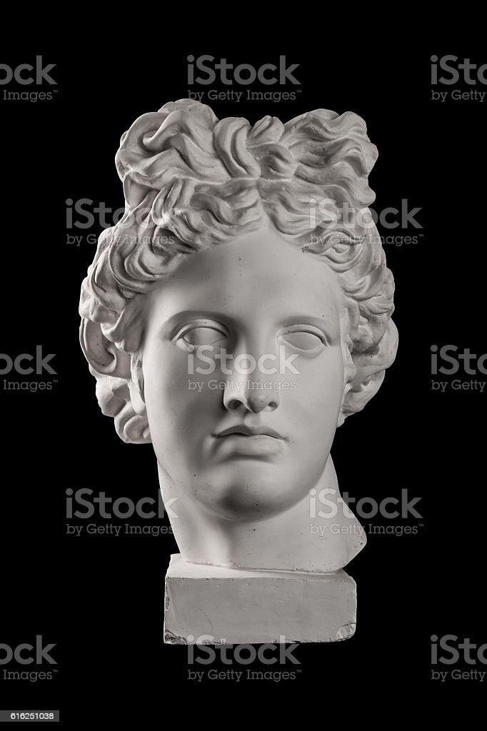 Gypsum statue of Apollo's head on a black background - Photo