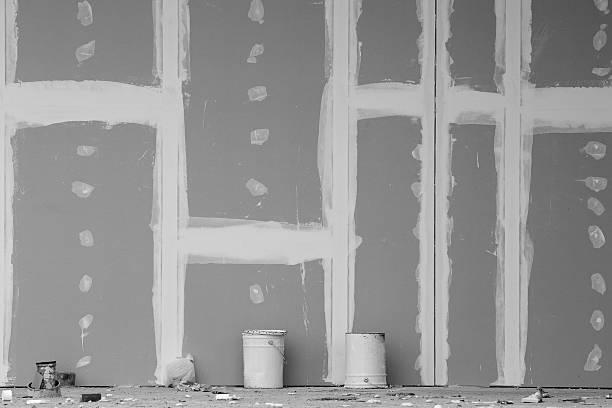 Gesso parede em construção - foto de acervo
