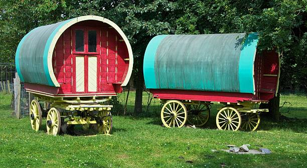 Gypsy Caravans A pair of horse-drawn gypsy caravans standing in a field in Ireland romani people stock pictures, royalty-free photos & images