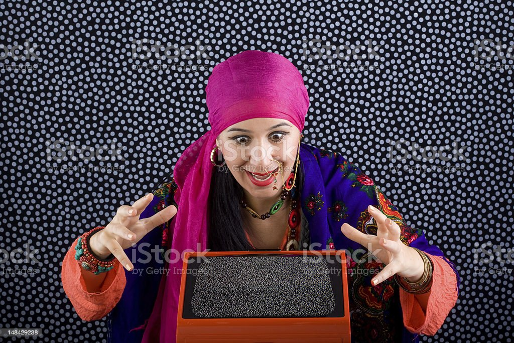 Gypsy Fortune Teller Concentrate On Television Stock Photo