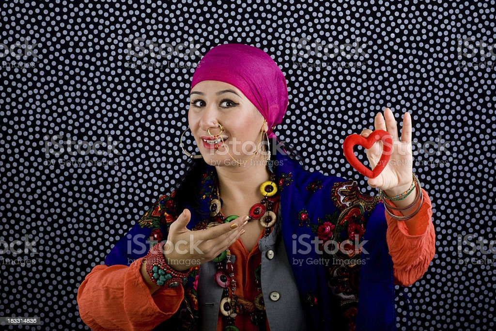 Gypsy Fortune Teller Holding Heart Shapped Object Stock