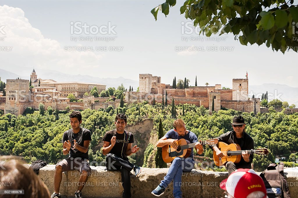 Gypsy musicians to Granada and the Alhambra in the background stock photo