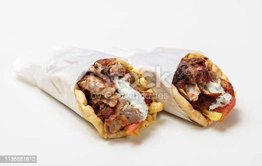 Gyro pita, shawarma, take away, street food. Two pita bread wraps with meat, traditional greek turkish food isolated on white background