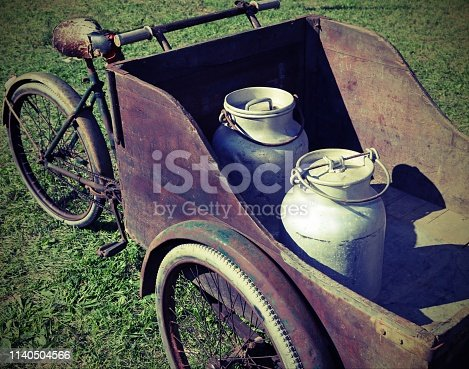 cart with old bicycle to transport the milk just leavened from the farm with vintage toned effect
