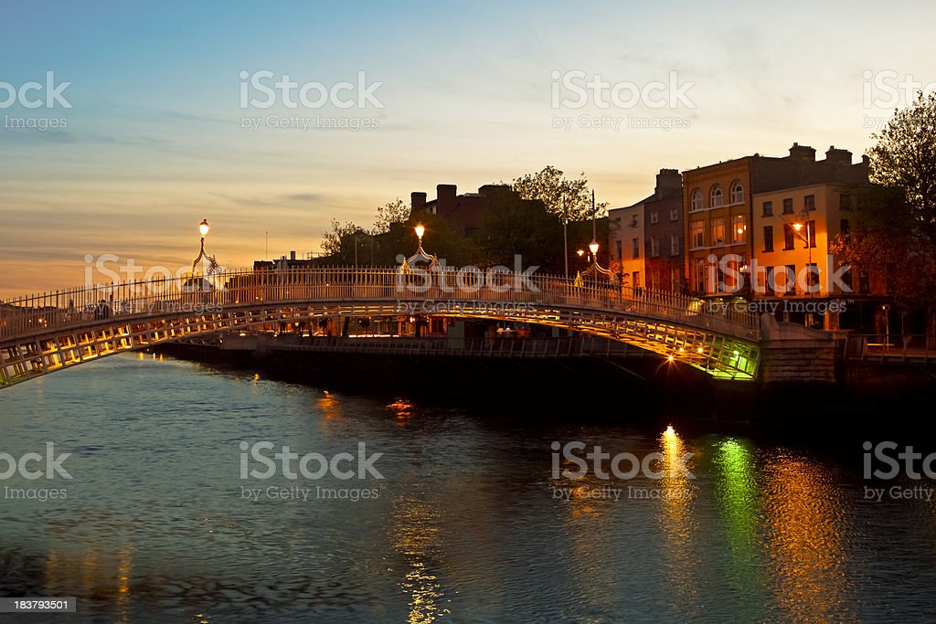 Ha Penny Bridge by night, Dublin, Ireland stock photo