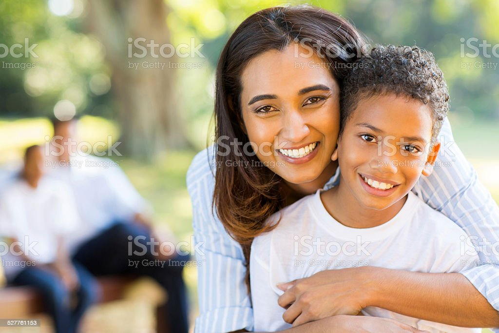 haapy indian mother hugging her son stock photo