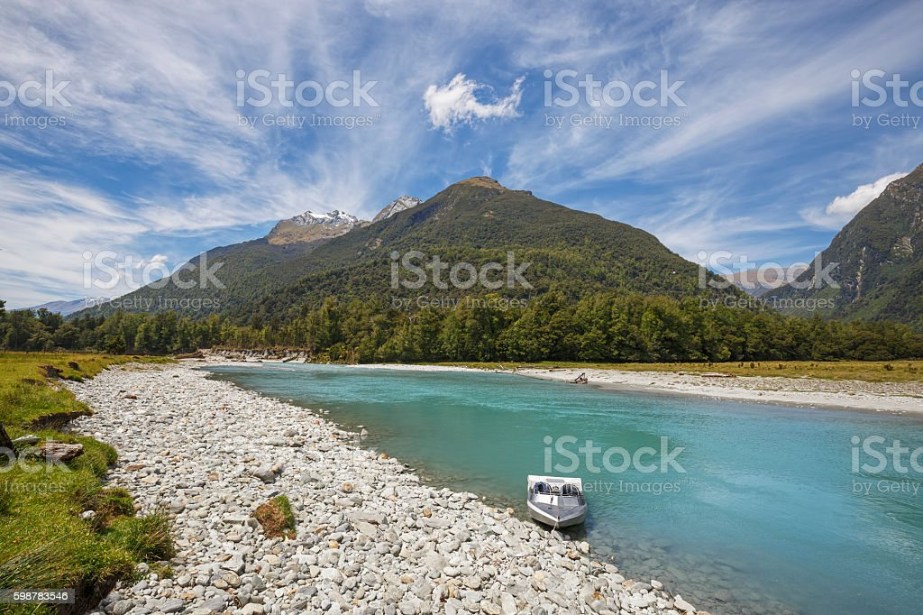Haast River and Jet boat, Haast, New Zealand. stock photo
