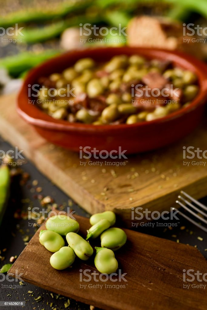 habas a la catalana, a spanish recipe of broad beans stock photo