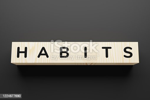 Habits are a word on toy blocks.