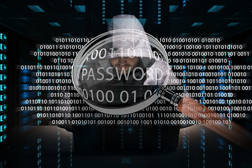 istock Hacker accessing to personal data information with a computer in a dark room 3D rendering 1211221934