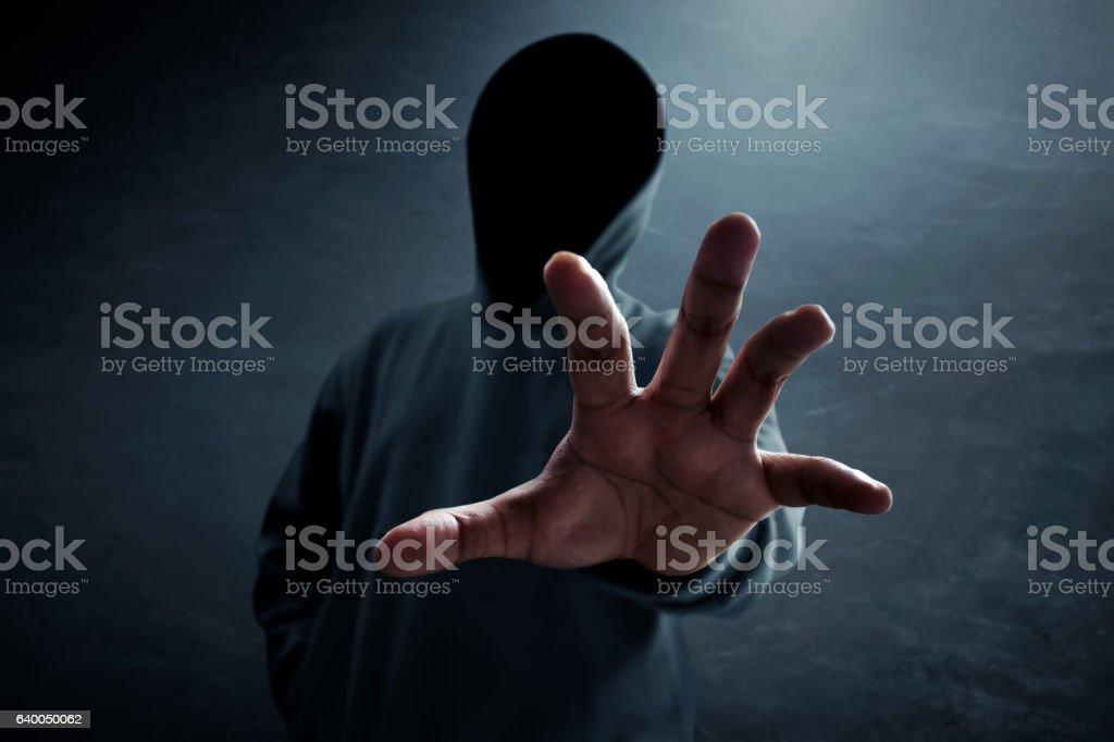 Hacker alone in dark room stock photo