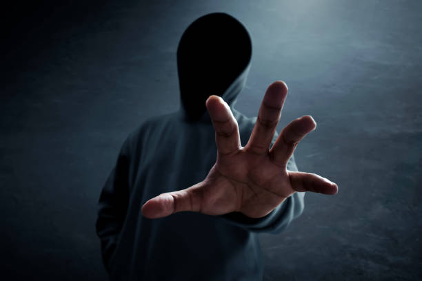 Hacker alone in dark room Hacker alone in dark room stranger stock pictures, royalty-free photos & images