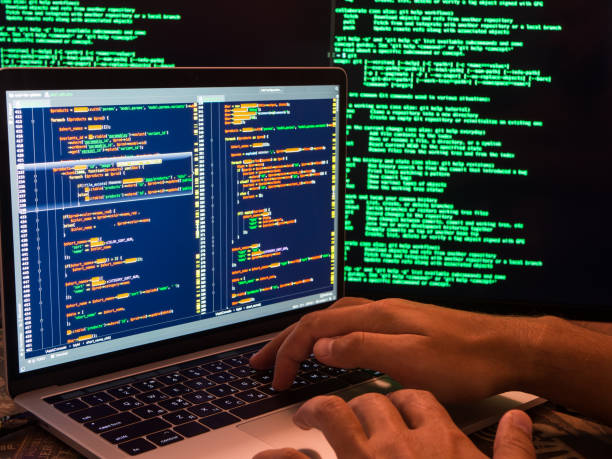 Hacker breaching the secure system in cyberspace using malicious code or virus program Hacker breaching the secure system in cyberspace, hands on keyboard php programming language stock pictures, royalty-free photos & images