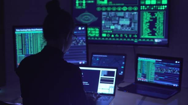 Hacker coding in cyberspace stock photo