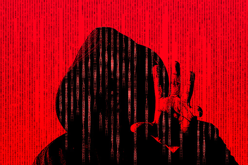 istock Hacker concept on red background with his hand grabbing something 805183952