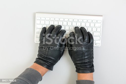 istock Hacker Hands breaking network protection on white keyboard 840176924