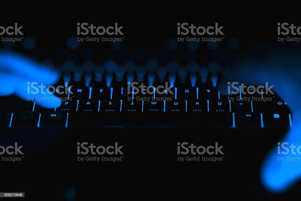 Hacker hands typing stock photo