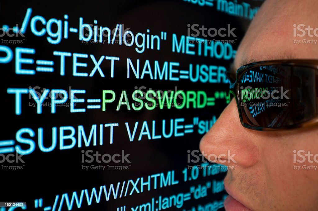 A hacker looking up close at some code royalty-free stock photo