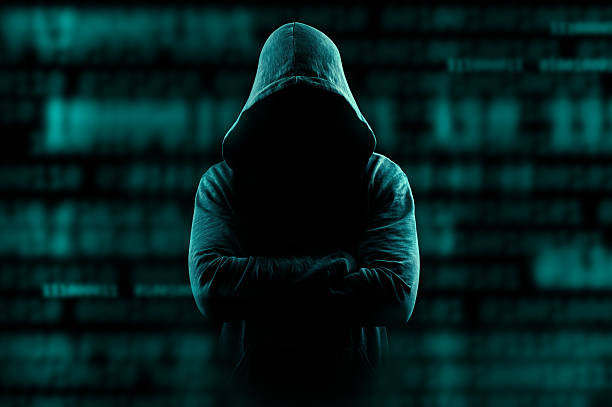 hacker lurking on internet - hacker stock photos and pictures