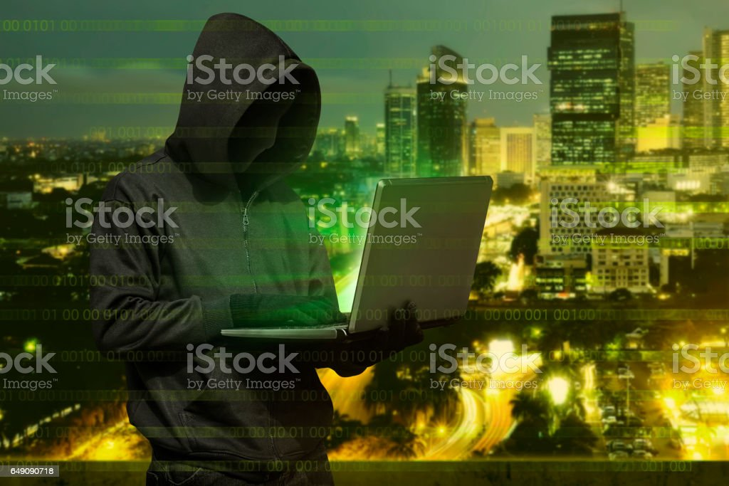 Hacker Man With Mask Typing On Laptop Stock Photo Download