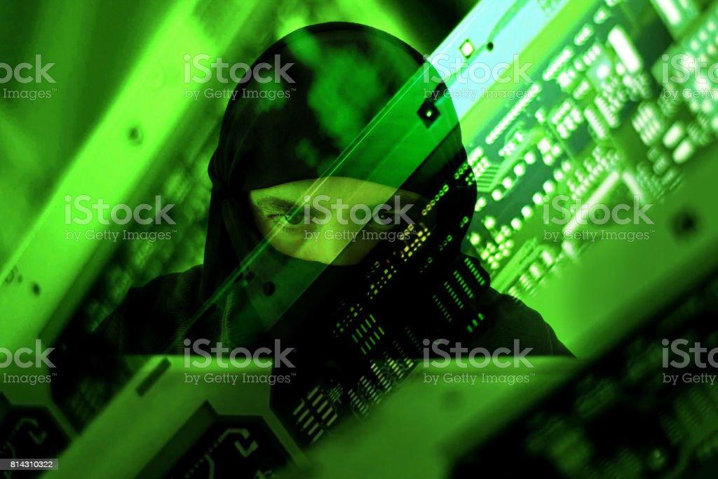 Hacker muslim terrorist attack from laptop stock photo