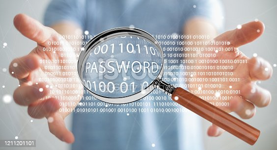 istock Hacker on blurred background using digital magnifying glass to find password 3D rendering 1211201101