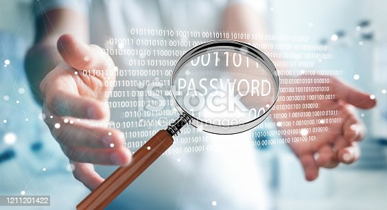 istock Hacker on blurred background using digital magnifying glass to find password 3D rendering 1211201422