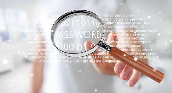 istock Hacker on blurred background using digital magnifying glass to find password 3D rendering 1211207397