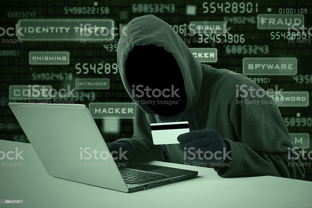 Hacker stealing credit card number stock photo
