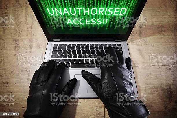 Hacker Stealing Data From A Laptop Stock Photo - Download Image Now