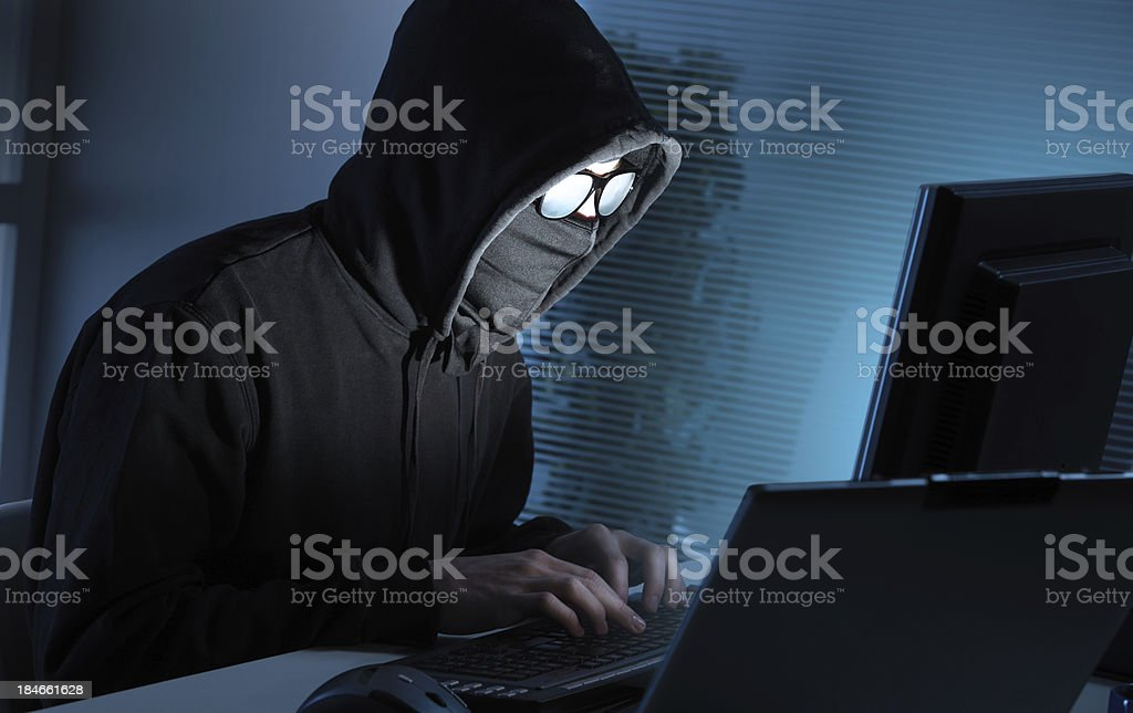 Hacker stealing data from computer stock photo