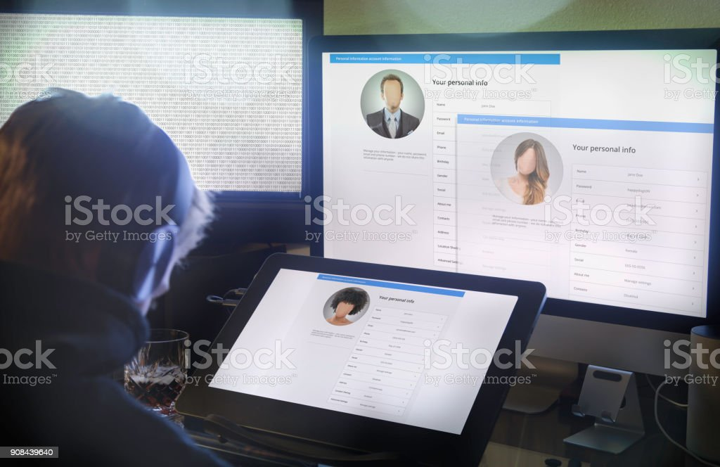 Hacker stealing your identity stock photo