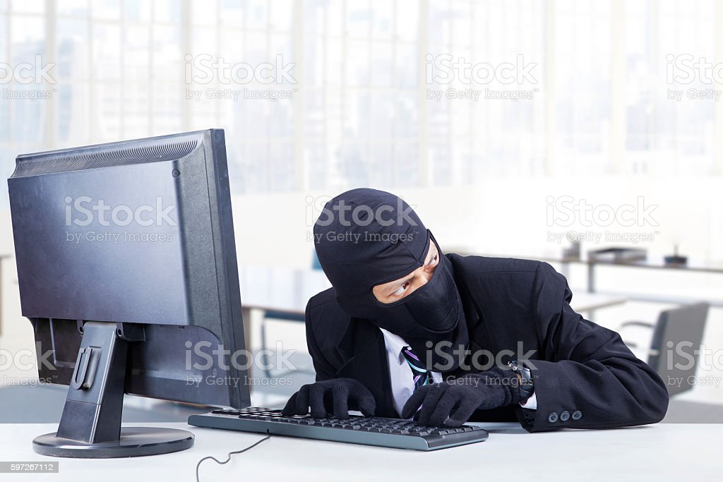 Hacker steals data in the office royalty-free stock photo