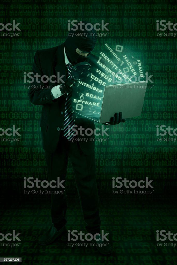 Hacker steals data with laptop royalty-free stock photo