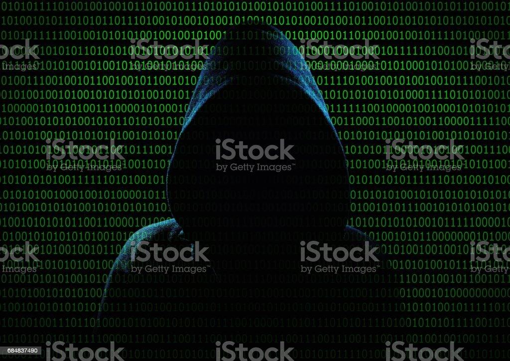Hacker. Unrecognizable person in the hood break computer codes.